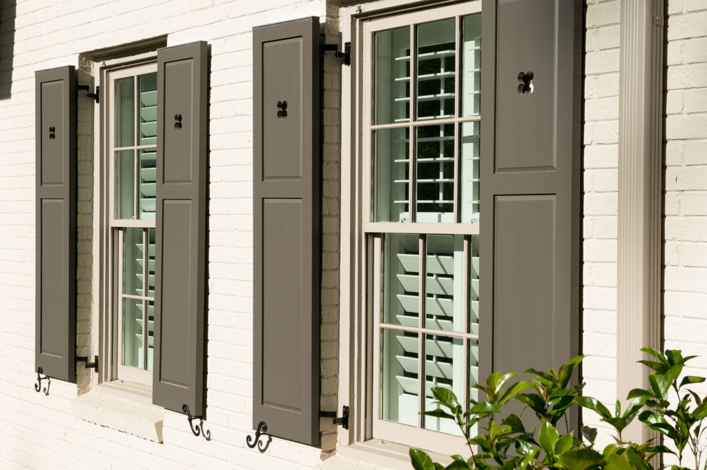exterior window detail with custom shutters