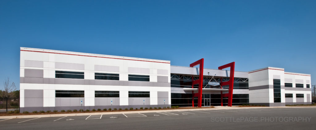 Architectural Photograph of NASCAR racing team Stewart Hass Racing shop and headquarters. Concord, NC